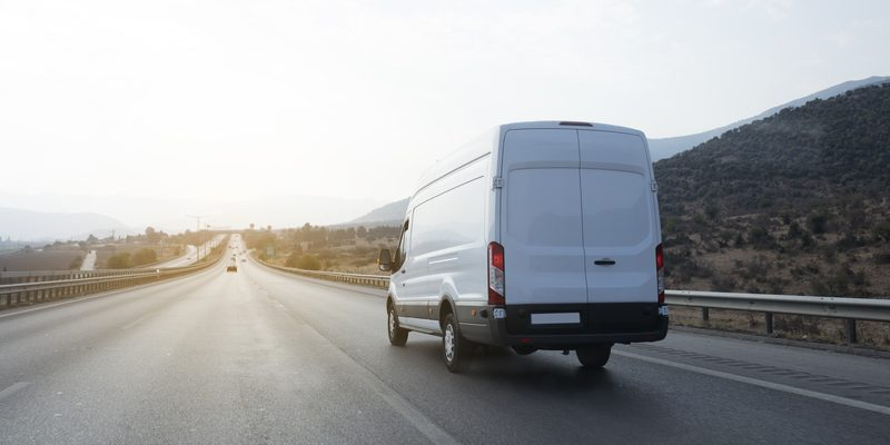 White Delivery Van on the road
